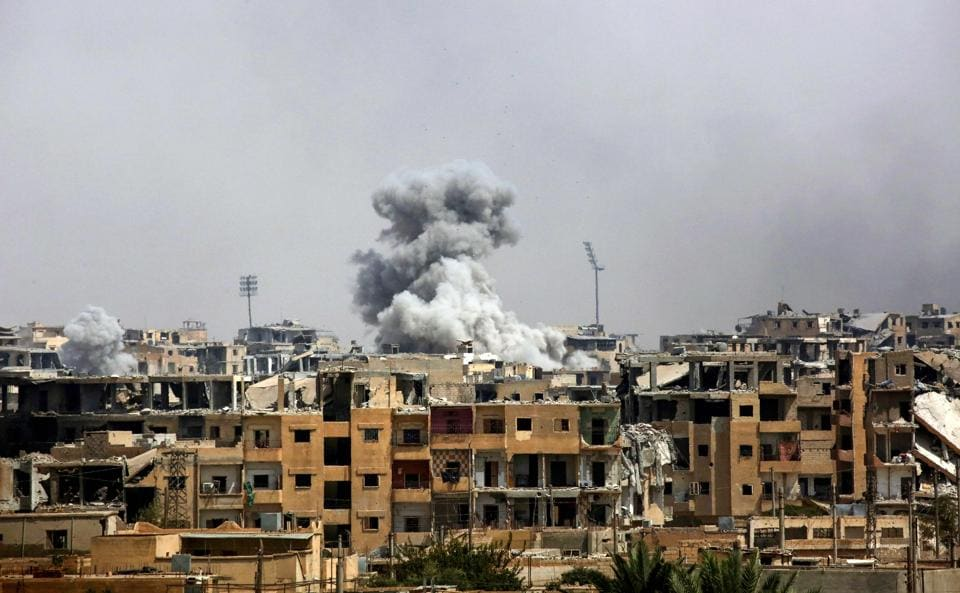 A picture taken on September 5, 2017 shows smoke billowing out following a coalition air strike in the western al-Daraiya neighbourhood of the embattled northern Syrian city of Raqa.