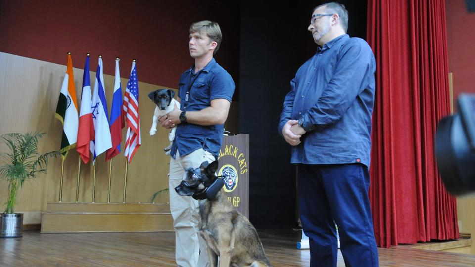 During the demonstration, Fizy, a dog trained by French trainer Thomas was made to wear specialized goggles that included high-definition cameras and asked to deliver a jamming device at the gate of the Niranjan auditorium, where the seminar was taking place.