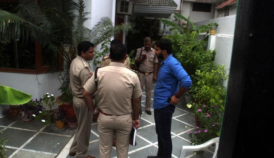 Police at the Sector 44, Noida, house where a private security guard was shot dead while trying to resist a robbery bid on Wednesday.
