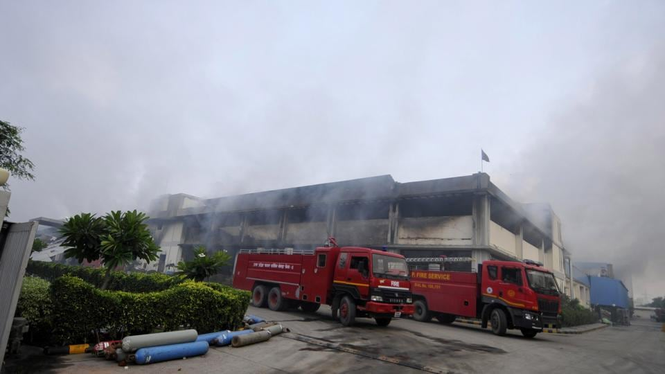 moke billowing out of the Haldiram's unit after 18 hours from the time it went up in flames.