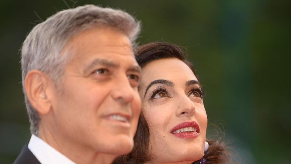 US actor and director George Clooney and his wife Amal attend the premiere of the movie Suburbicon presented out of competition at the 74th Venice Film Festival.
