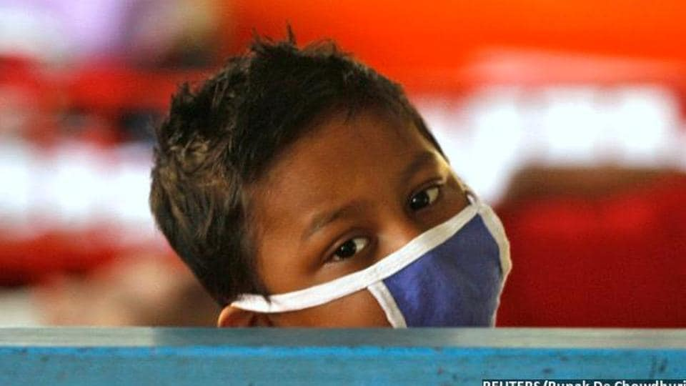 A young cancer patient rests in the children's ward at the Cancer Centre Welfare Home and Research Institute in Kolkata.