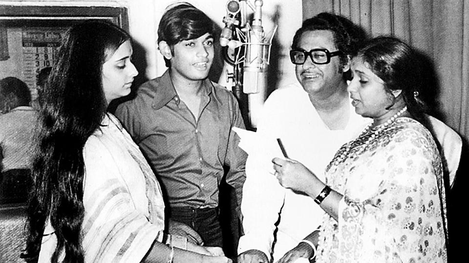 Asha Bhosle and Kishore Kumar seen during an undated recording session. In 2011 Bhosle entered the Guinness Book of World Records as the most recorded artiste in history with over 11,000 songs. She was also the recipient of the Dada Sahab Phalke Award in 2000 and Padma Vibhushan in 2008. (HT Photo)