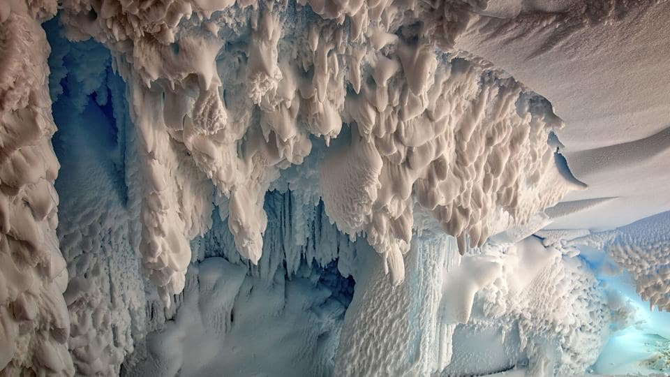 This undated hand out picture released by the Australian National University on September 8, 2017 and taken by Joel Bensing shows inside view of an ice cave on the Erebus Glacier tongue, Ross Land, Antartica near McMurdo Station and Scott Base.