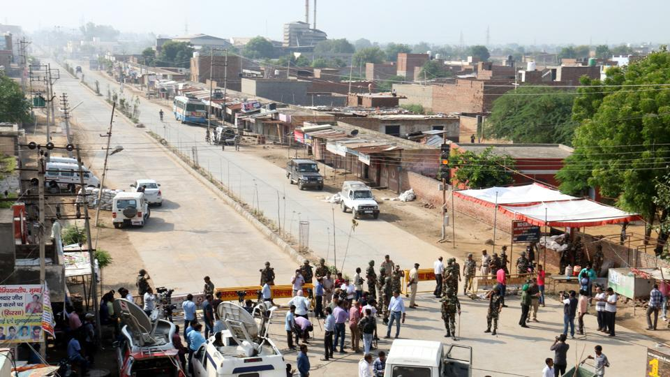 A road leading to one of the Dera Sacha Sauda campus is blocked by police on Friday.