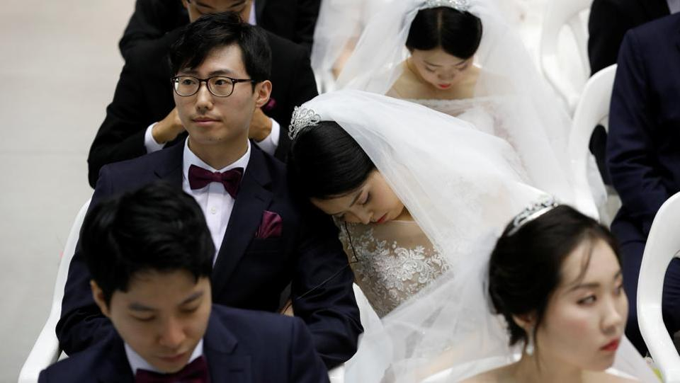 A Bride Naps As Newlywed Couples Attend The Mass Wedding Ceremony On September 7 2017 Escaping During Korean War Moon Founded Church In South