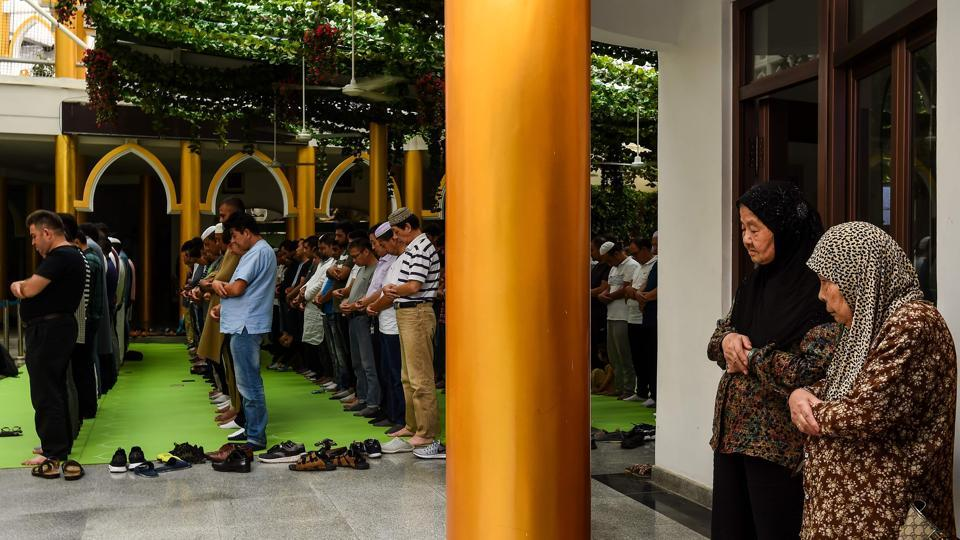 Muslims offer Friday prayers inside a mosque in Shanghai on September 8, 2017. China has tightened regulations on religious freedom, intensifying punishments for unsanctioned activities and increasing its supervision of certain groups in a bid to