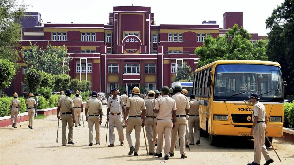 Police team arrive to investigate after the murder of a second standard student of Ryan International School in Gurgaon.