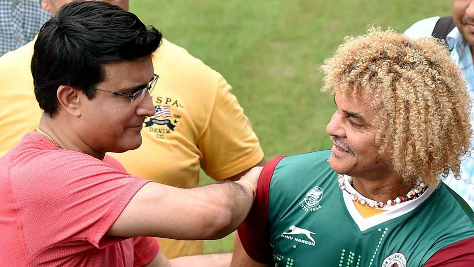 Carlos Valderrama and former Indian cricket team captain Sourav Ganguly share a lighter moment. (PTI)