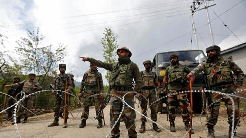 Indian army soldiers stand guard inside their army base after it was attacked by suspected separatist militants in Panzgam in Kashmir's Kupwara district, April 27. Men have traditionally dominated combat roles in the army, with only a handful of countries worldwide opening these positions to women.