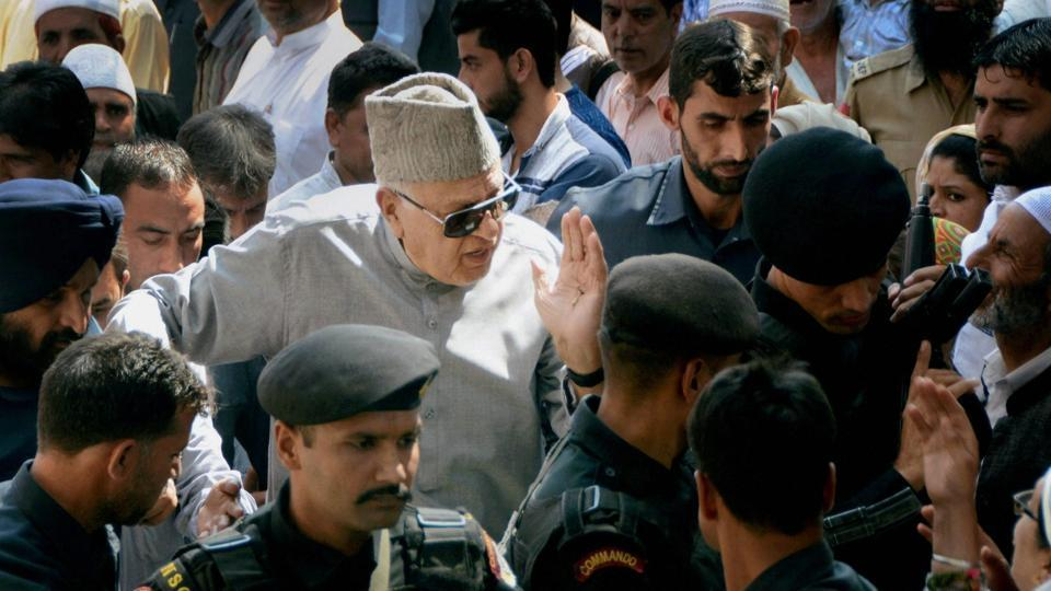 Member Parliament and National Conference president Farooq Abdullah interacts with party supporters after offering special prayers at the graveyard of his father and founder of National Conference Sheikh Abdullah on his 35th death anniversary, in Srinagar on Friday.