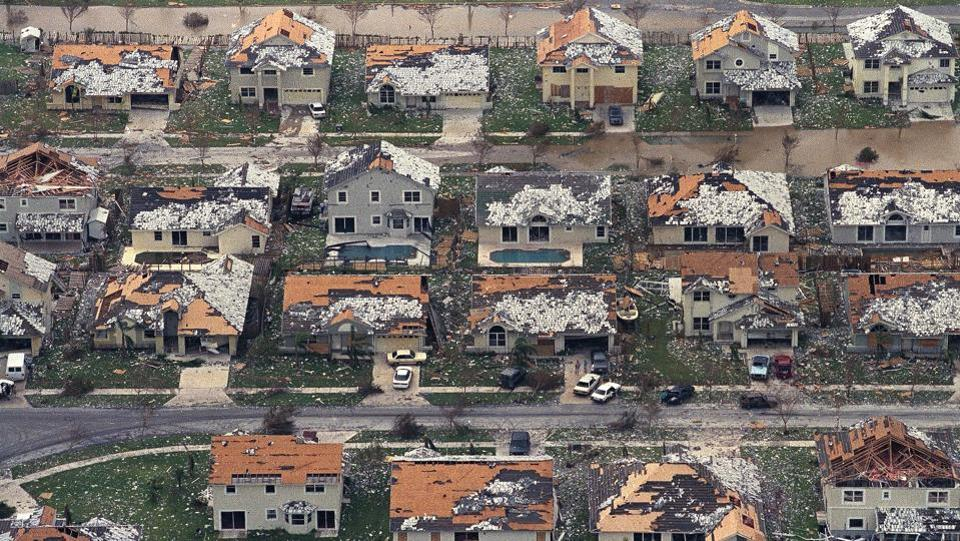 In this August 25, 1992, file photo, rows of damaged houses sit between Homestead and Florida City after Hurricane Andrew struck. Hurricane Andrew was a category 5 hurricane, the worst ever to hit the state with sustained wind speed of 165 miles per hour.  (AP)