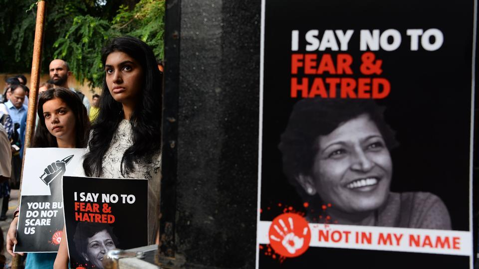 Demonstrators hold placards with the photograph of Gauri Lankesh during a 'Not In My Name' protest in New Delhi on September 7, 2017.