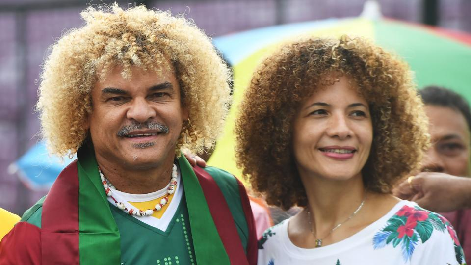 Carlos Valderrama, who played in three World Cup tournaments, poses for pictures with his wife Elvira. (AFP)