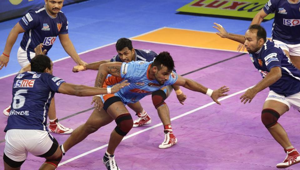 Bengal Warriors raider Maninder Singh (centre)tries to avoid being pinned down by Dabang Delhi players during their Pro Kabaddi League (PKL)match in Kolkata on Thursday.