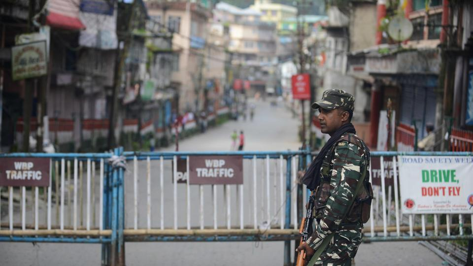 Paramilitary forces stand guard along a road in Kalimpong.  The north Bengal hills have been reeling under an indefinite strike  called by the Gorkha Janmukti Morcha (GJM)  to demand a separate Gorkhaland state.