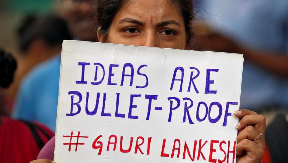 People attend a protest in New Delhi against the killing of senior journalist Gauri Lankesh.