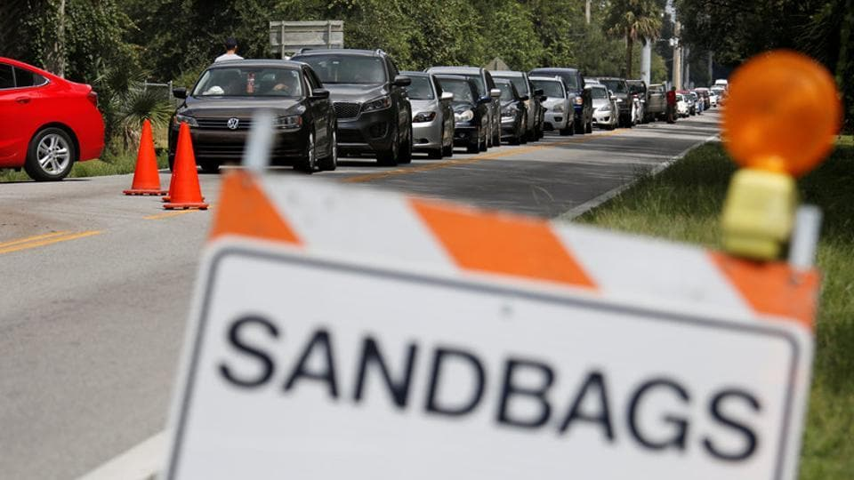 Motorists form a long queue to get sandbags at Kissimmee, in preparation for the arrival of Hurricane Irma making landfall  in Florida, U.S. In Miami, hundreds lined up for bottled water and cars looped around city blocks to get gas on Thursday in panicked preparations. Gas shortages in the Miami-Fort Lauderdale area worsened on Thursday, with sales up to five times the norm. (Gregg Newton / REUTERS)