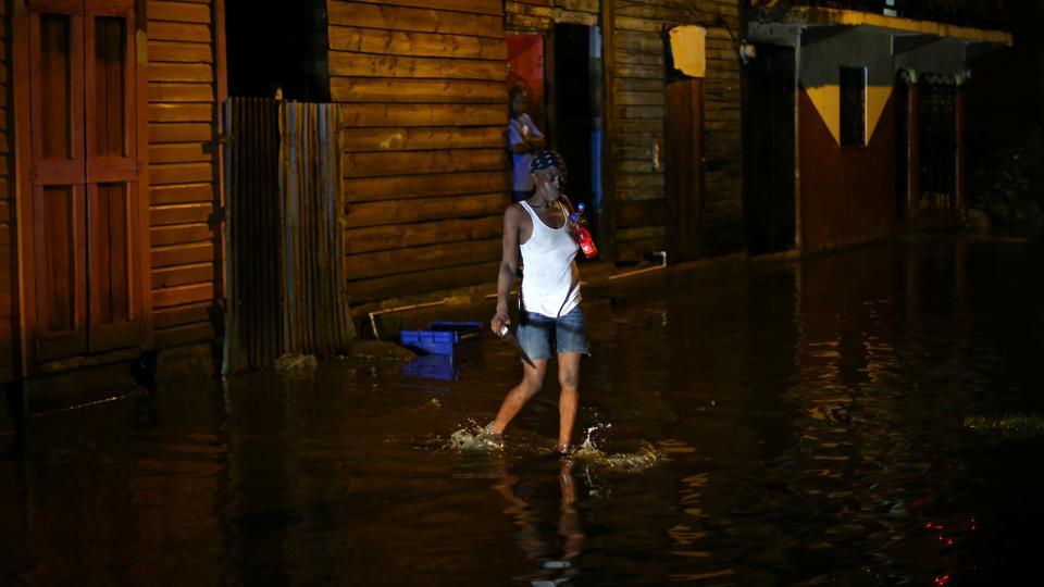 A woman walks through a flooded street after Hurricane Irma hit  Dominican Republic in Puerto Rico. Across the Caribbean, authorities rushed to evacuate tens of thousands of residents and tourists in the path of the storm. Another major hurricane, Jose, currently a Category 3 is expected to hit the northeastern Caribbean on Saturday. (Ivan Alvarado / REUTERS)