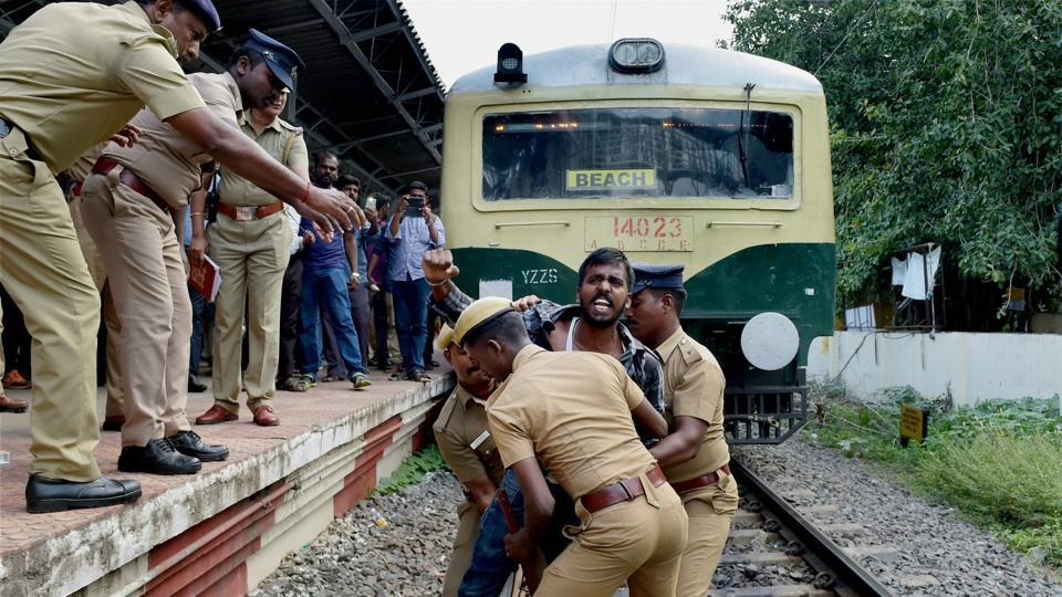 Police remove protester from railway track during protest over the suicide of 17-year-old  Anitha, who had moved the Supreme Court against NEET- based medical examinations