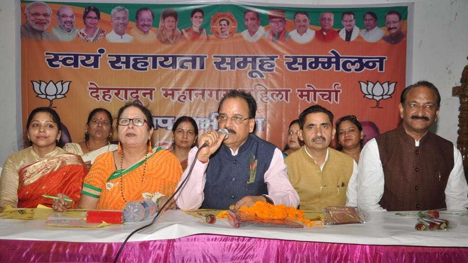 BJP state unit chief Ajay Bhatt addresses party workers in Dehradun on Friday.