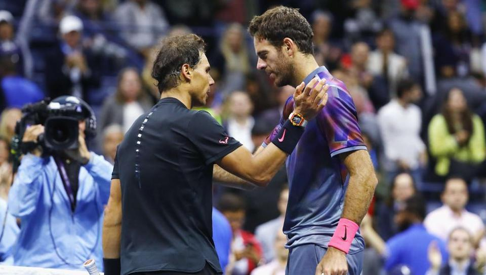 Rafael Nadal (L)of Spain talks with Juan Martin del Potro of Argentina after their men's singles semifinal at the 2017 US Open on Friday in New York City. Nadal won 4-6, 6-0, 6-3, 6-2.