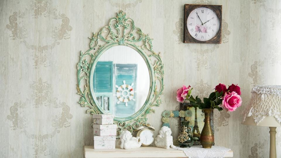 Decorative or antique mirrors can help create the illusion of spaciousness in a small apartment.