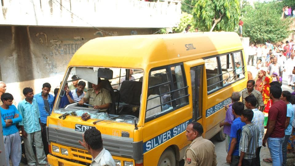 The school bus which was vandalised after a kindergarten student  came under one of its wheel allegedly due to the driver's recklessness .