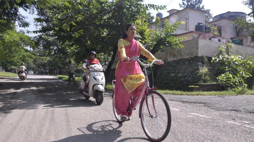Uttarakhand women and child development minister Rekha Arya trains for her 55-km cycle rally.