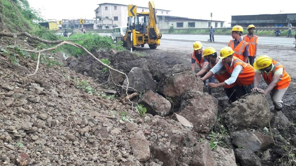 Workers from the Public Works Department (PWD) clear the rubble from the landslide, which took place near Rehamania Hospital in Thane