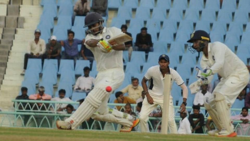 India Red's Priyank Panchal plays a sweep shot for a boundary in the Duleep Trophy on Saturday in Lucknow.
