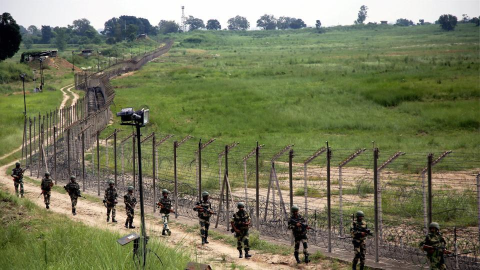Indian security personnel patrol the fence along the international border. Pakistan fired at Indian positions in Poonch district on Saturday.