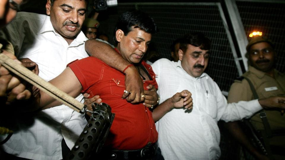An Indian court on September 9, sentenced Abu Salem (red shirt) to life imprisonment over bomb blasts in Mumbai. (Manpreet Romana / AFP File Photo)