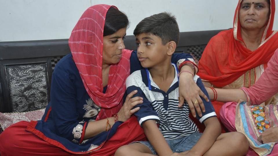The rescued boy with his mother.