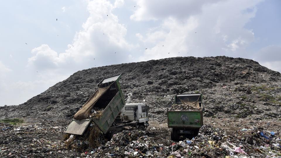 Trucks dumping garbage at the Ghazipur Landfill site in New Delhi.