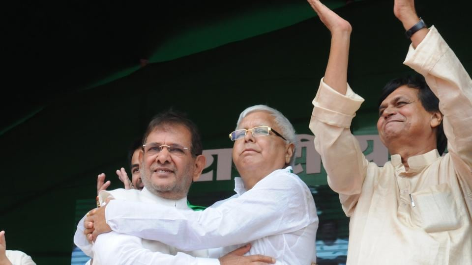 RJD chief Lalu Prasad with JD(U) leader Sharad Yadav at an opposition rally in Patna on August 27.
