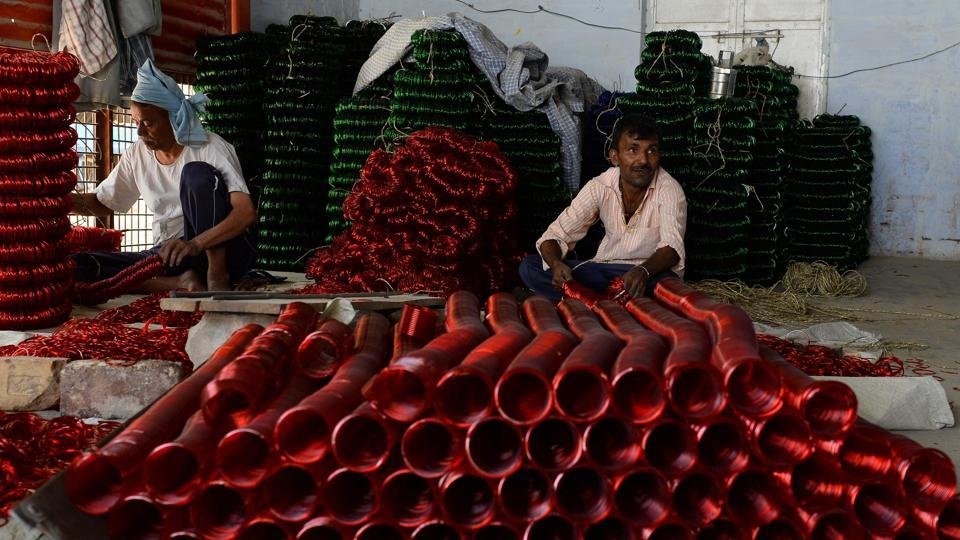 A worker packs glass bangles at a factory in Firozabad.