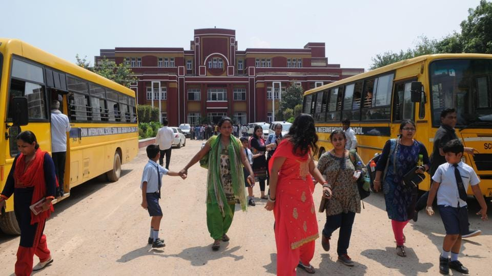 Parents take their children home after the murder of a second grader at Ryan International School in Gurgaon on Friday.