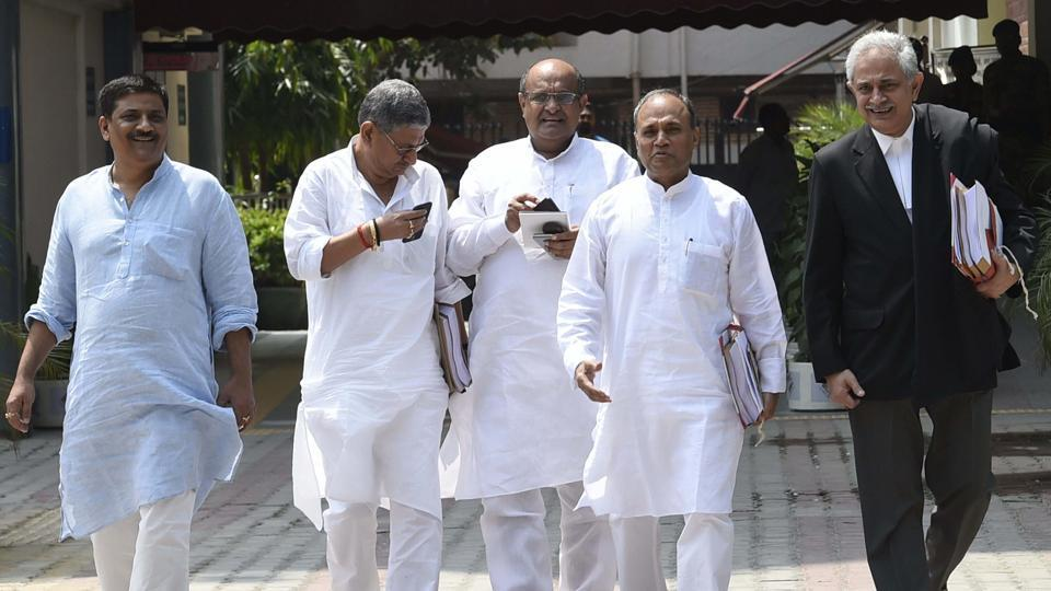 JD(U) delegation comprising KC Tyagi, RCP Singh, Sanjay Jha and Rajiv Ranjan Singh comes out of the Election Commission office after a meeting regarding their party symbol in New Delhi on Friday.