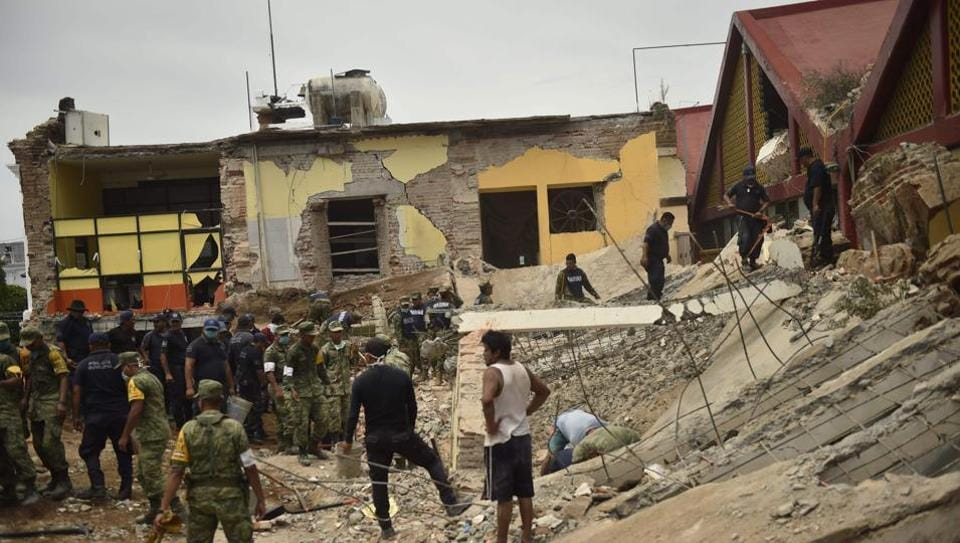 Police officers and members of the Armed Forces work amid the debris of the Town Hall building in Juchitan de Zaragoza, State of Oaxaca, which partially collapsed following an 8.2 earthquake that hit Mexico's Pacific coast overnight on Thursday.