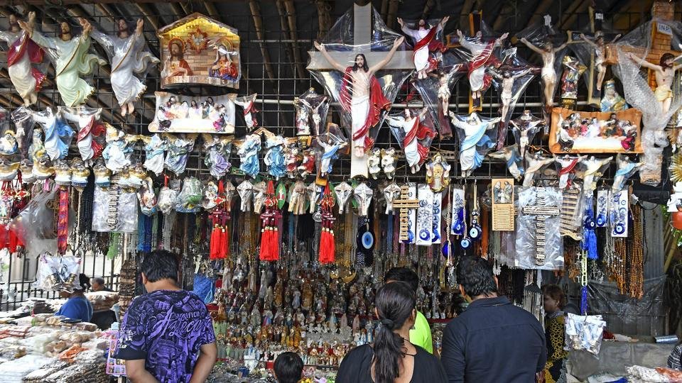 Shopkeepers decorate stalls before Mount Mary Fair in Bandra on Thursday.