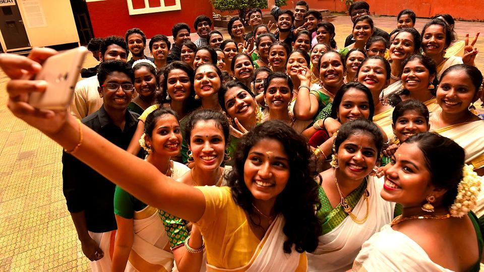 Students of the Malayalam Association take a group selfie dressed in tradition attire. (Anshuman Poyrekar/HT Photo)