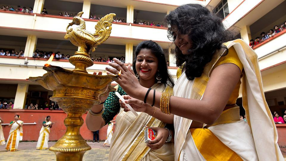Students of the Malayalam Association of SIES College sparked off Onam festivities by lighting a lamp. (Anshuman Poyrekar/HT Photo)