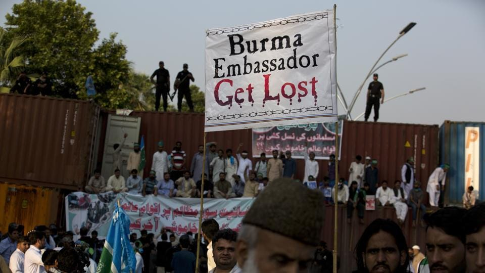 Pakistani protesters stand on shipping containers, authorities put to barred them from marching to the Myanmar Embassy during a protest to condemn the violence against the Rohingya Muslim in Myanmar, in Islamabad on September 8.