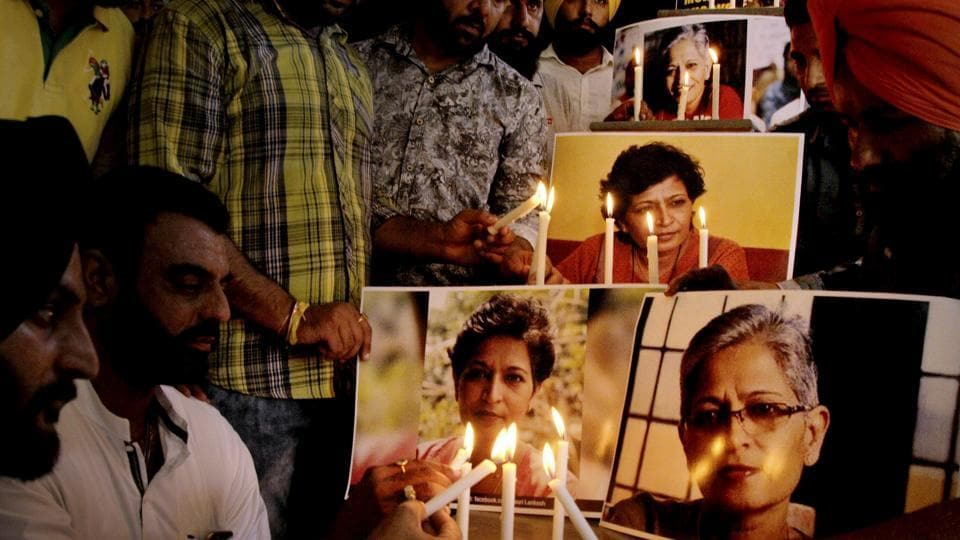 Members of the National Human Rights and Crime Control Organisation in a candle-light vigil in Amritsar on Friday to condemn the killing of journalist Gauri Lankesh.