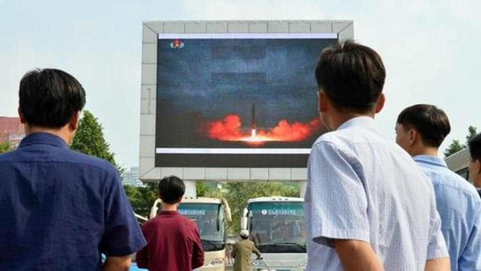North Koreans watch a news report showing North Korea's Hwasong-12 intermediate-range ballistic missile launch on electronic screen at Pyongyang station in Pyongyang, North Korea, in this photo taken by Kyodo August 30, 2017. Mandatory credit Kyodo/ via REUTERS