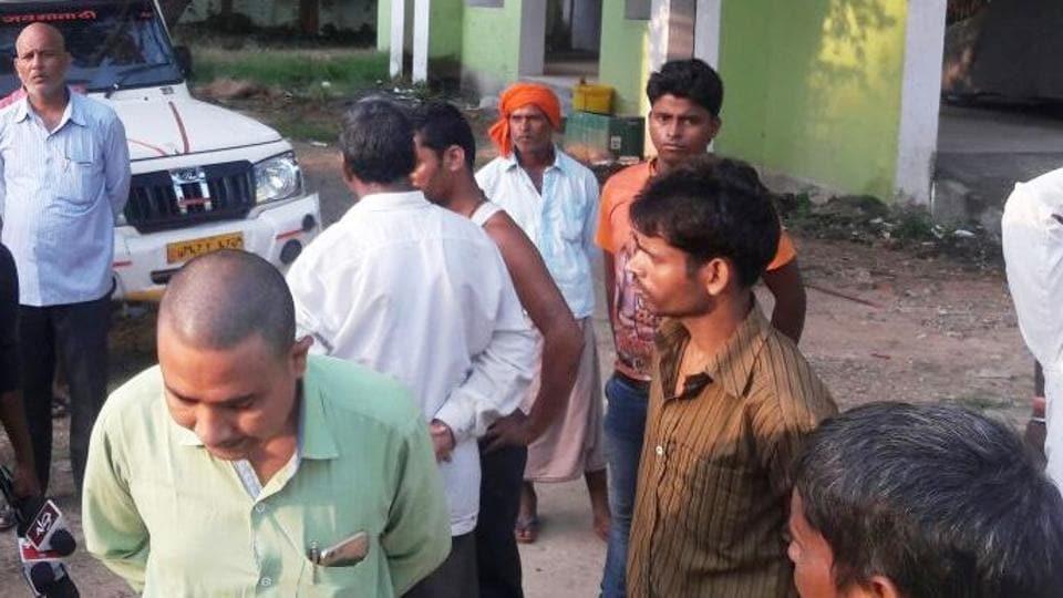 Relatives of the slain couple at Bahbua sadar hospital .