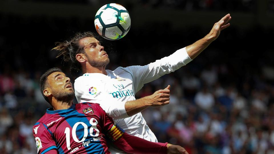 Levante's Pedro Lopez in action with Real Madrid's Gareth Bale during their La Liga encounter.
