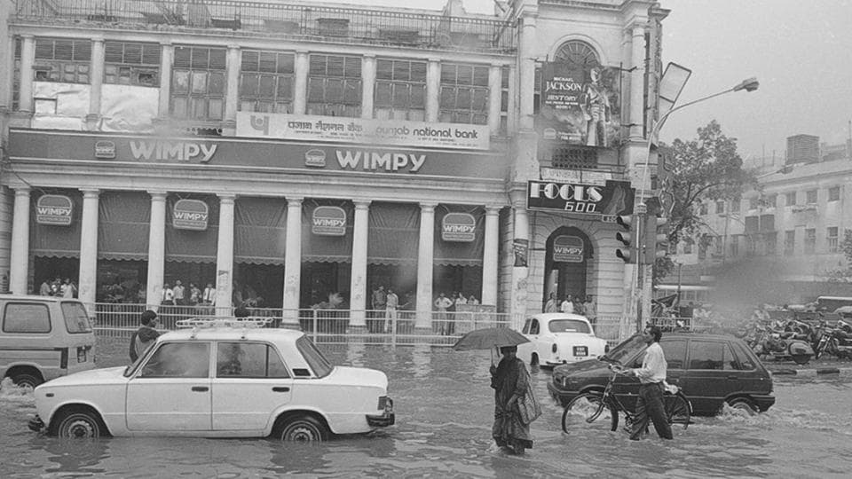 Connaught Place battling the rains in 1995. This year, the Safdarjung observatory recorded around 6.6mm of rain until Thursday morning, while Ayanagar and Ridge areas registered a fair amount of rainfall. (SN Sinha / HT Photo)