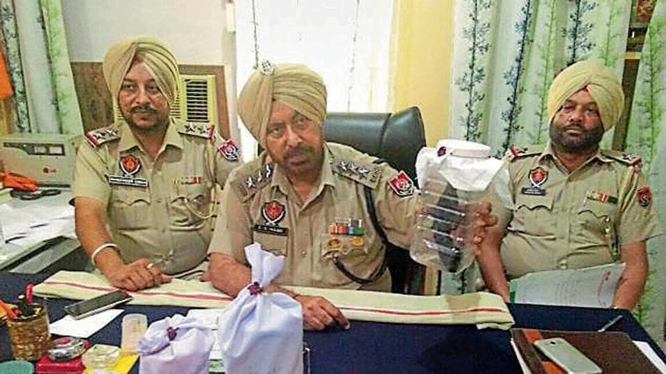 Police showing the recovered items during a press conference at Bhikhiwind in Tarn Taran on Saturday.